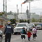Kids walking near oil refinery